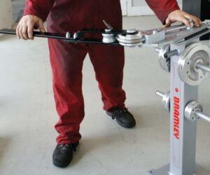 Model TBSQ shown in use and mounted on optional stand (Model: TBSTAND) which incorporates storage pegs for formers.